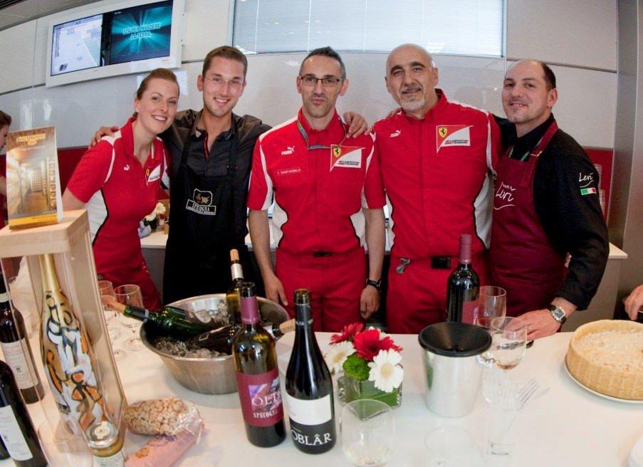 I vini dell'azienda agricola Specogna e il prosciutto San Daniele Levi della Bottega del Prosciutto insieme nel motorhome Ferrari