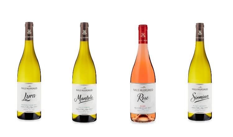 Quattro vini che raccontano l'estate in Alto Adige: tre bianchi e un rosé di Nals Margreid per un brindisi che esalta il territorio